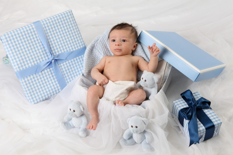 Newborn baby in gift box for mom and dad