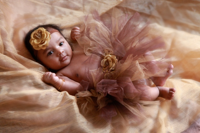 Newborn Baby girl wearing gold tutu
